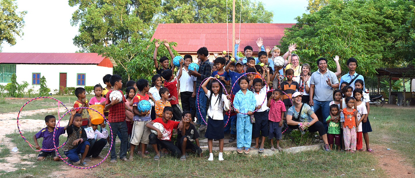 Tracy Evans team gift the children with sports equipment