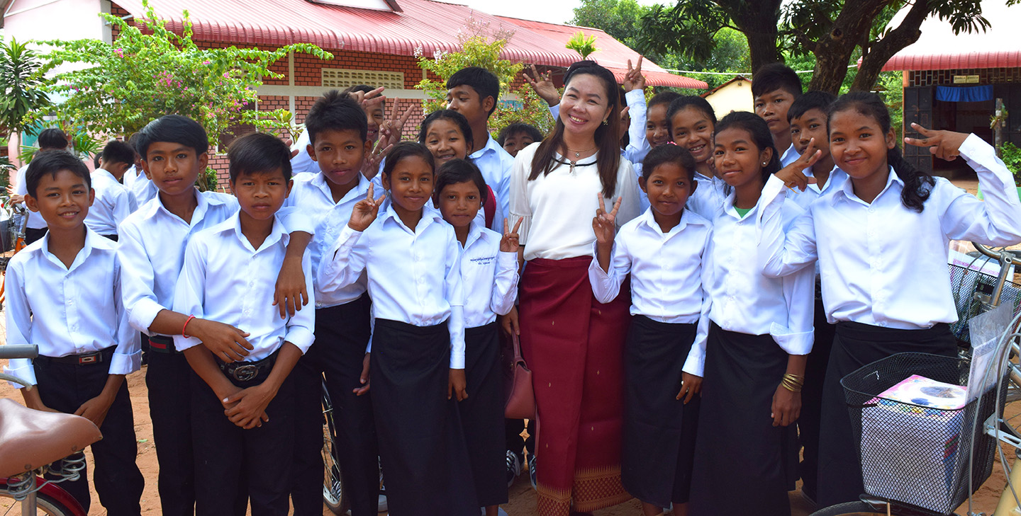 Teacher Chhiv Ley with students