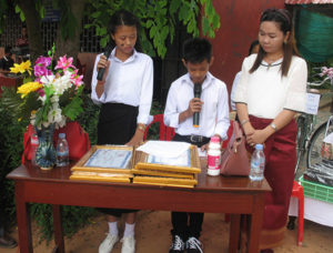 Students MC the ceremony with teacher Chhiv Ley