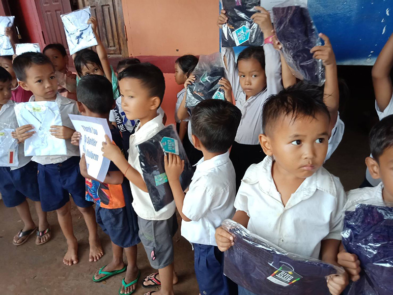 students receiving new uniforms